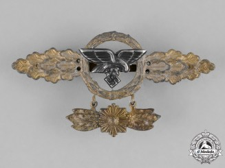 Germany, Luftwaffe. A Luftwaffe Front Flying Clasp for Transport Pilots with Star Pendant, Gold Grade