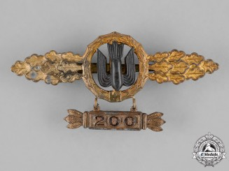 Germany, Luftwaffe. A Bomber Pilot's Clasp with Star Pendant, Gold Grade, By Richard Simm & Söhne