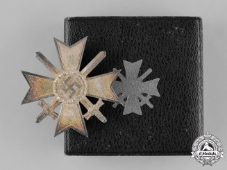 Germany, Wehrmacht. A War Merit Cross First Class with Swords by Deschler & Sohn