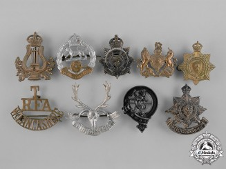 United Kingdom. Nine First War Cap Badges