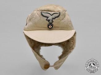 Germany, Luftwaffe. A Fur & Leather Winter Cap, 1943