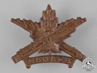 Canada. A Canadian Machine Gun Corps Officer's Cap Badge, Style D with Maple Leaf Design