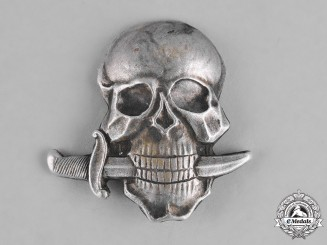 Italy, Kingdom. An Italian Black Brigade Skull Cap Badge, c.1942