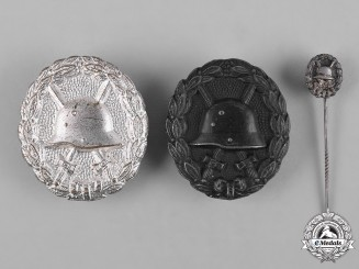 Germany, Imperial. A Pair of Wound Badges, Silver and Black Grades, and a Stickpin