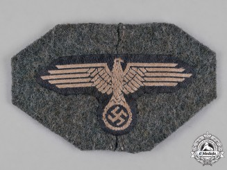 "Germany, SS. A Waffen-SS Field Cap Eagle, ""Cut Off Version"""