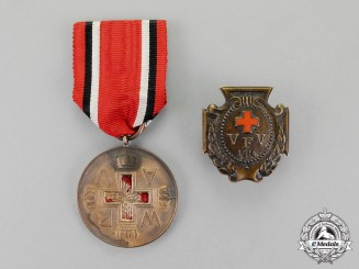 Germany, Imperial. A Grouping of Two Imperial Red Cross Medals and Badges