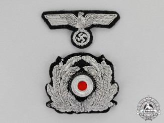 Germany, Third Reich. A Mint and Unissued Set of Kriegsmarine Officer's Visor Cap Insignia