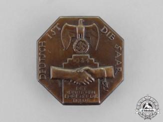 "Germany. A 1934 ""The Saar is German"" Celebration badge"