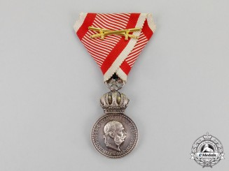 Austria, Imperial. A Silver Military Merit Medal, in Solid Silver, With Wartime Ribbon and Swords