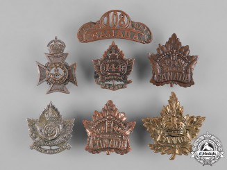 Canada, United Kingdom. A Lot of Seven First War Cap Badges