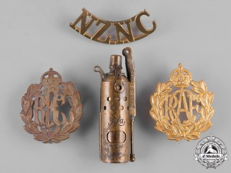 Austria, Canada, New Zealand, United Kingdom. Lot of Three Badges and one Cigarette Lighter