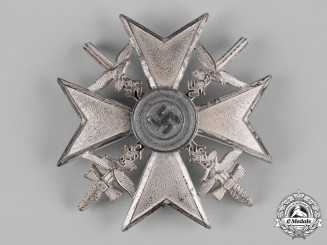 Germany, Wehrmacht. A Spanish Cross in Silver with Swords by Berg & Nolte