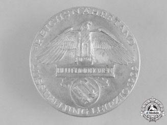 Germany, Third Reich. A 1939 Blood and Soil Leipzig Exhibition Badge, by Deschler & Sohn