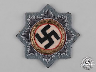 Germany, Wehrmacht. A German Cross in Gold, Cloth Version, by Hermann Schmuck & Cie