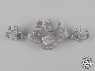Canada. A Newfoundland Pipe Band Cap Badge &  Royal Newfoundland Regiment Collar Tab Pair