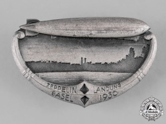 Switzerland, Republic. A 1930 Basel Zeppelin Landing Commemorative Badge by Huguenin Frères & Co.