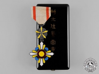 China, Occupied Manchukuo.  An Order of the Auspicious Clouds, VI Class , c.1935
