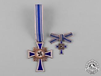 Germany, Third Reich. An Honour Cross of the German Mother, Bronze Grade, with Miniature