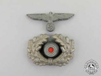 Germany. A Second War Period Wehrmacht Heer (Army) Set of Officer's Visor Cap Insignia