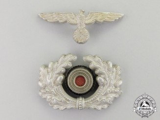 Germany. A Wehrmacht Heer (Army) Officer's Visor Cap Insignia Set