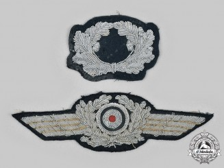 Germany, Wehrmacht. A Pair of Visor Cap Insignia