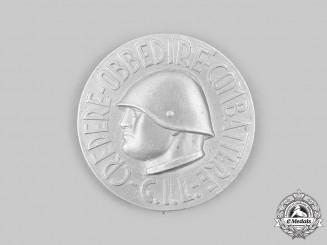 """Italy, Kingdom. A Fascist Youth """"Gioventù Italiana del Littorio"""" (GIL) """"Credere Obbedire Combattere"""" Badge"""