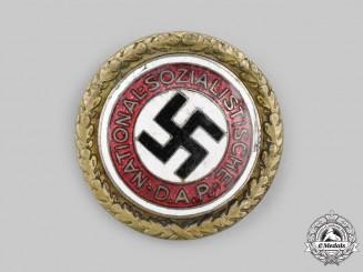 Germany, NSDAP. A Golden Party Badge, by Deschler & Sohn, to Karl Kriegelstein