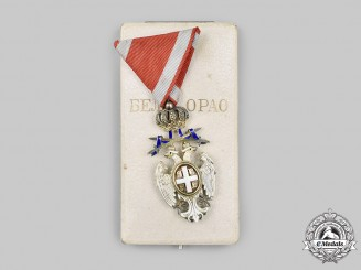 Serbia, Kingdom. An Order of the White Eagle, V Class Knight with Swords, by Huguenin Freres & Co., c.1918