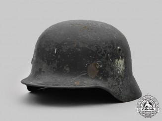 Germany, Heer. A Battle-Damaged Heer M40 Steel Helmet