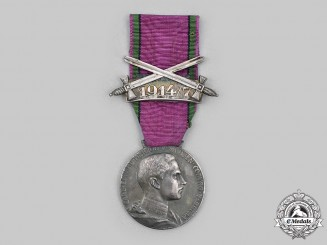 Saxe-Coburg and Gotha, Duchy. An Saxe-Ernestine House Order Silver Merit Medal, with 1914-17 Clasp
