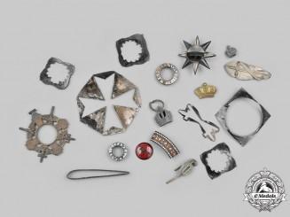 International. A Lot of Seventeen Assorted Fire Damaged Medal Parts