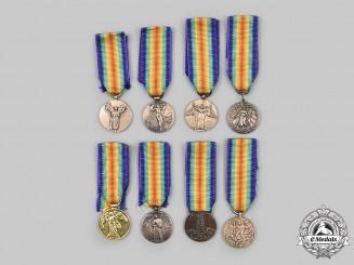 International. A Lot of Eight First War Replica Miniature Victory Medals