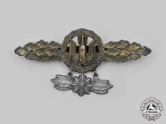 Germany, Luftwaffe. A Bomber Clasp, Gold Grade with Star Pendant