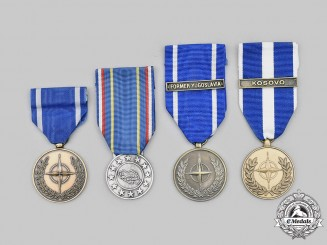 International. Lot of Four Medals