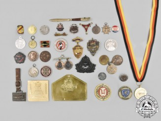 International. A Lot of Thirty-Nine Medals, Badges, and Insignia