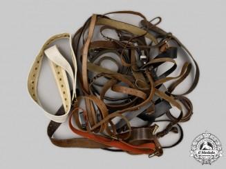 International. A Lot of Twenty-One Post-1945 European Belts and Straps