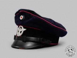 Germany, Feuerschutzpolizei. An EM/NCO's Visor cap, by Martin Ruhland