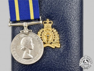 Canada, Commonwealth. A Royal Canadian Mounted Police Long Service Medal, B.E. Lane