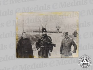 Yugoslavia, Serbia. A Chetnik Soldier with a Catholic Priest and a German Officer Photograph, c. 1943