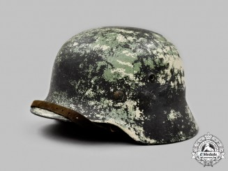 Germany, Heer. An M40 Stahlhelm with Field-Applied Camouflage