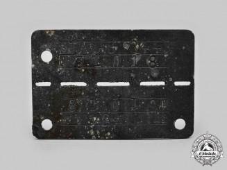 Germany, Third Reich. A Stalag-344 Allied POW Identification Tag