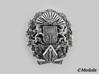 Latvia, Republic. A Military Badge to VItn. Abols, by W.F. Muller