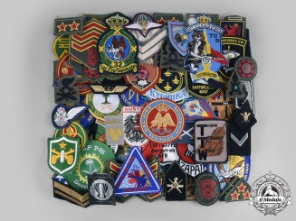 International. A Lot of Seventy-Four Regimental Insignia