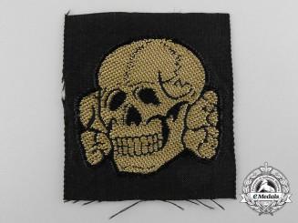 A Waffen-SS Tropical Totenkopf Cap Insignia