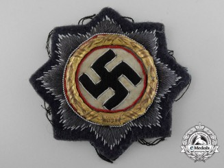 A Kriegsmarine German Cross in Gold; Cloth Version