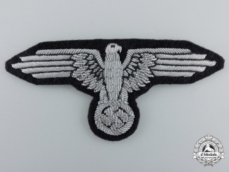 An Early SS Officer's Sleeve Eagle; RZM Tagged