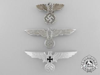 A Lot Of Three German Eagle Cap Badges