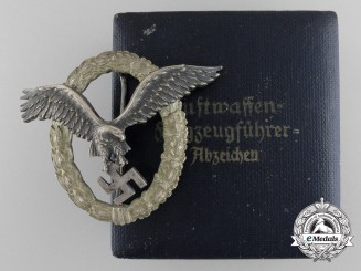 An Early Cased Luftwaffe Pilot's Badge by Juncker; J-1