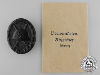 A Mint Black Grade Wound Badge with Packet by Hauptmünzamt, Wien