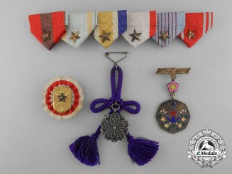 Four Second War Period Japanese Badges & Insignia